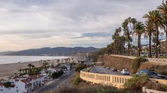 Santa Monica Landscape PCH Cars Traffic Sunset Palm Trees Beach Stock Photos