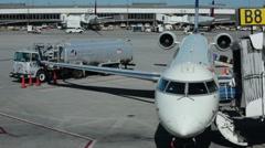 Salt Lake City Utah airplane at arrival gate passengers HD Stock Footage