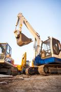 Excavator machines  on the construction site Stock Photos