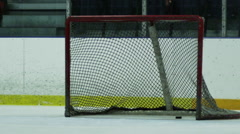 Slow Motion Hockey - Puck in the net with no goalie Stock Footage