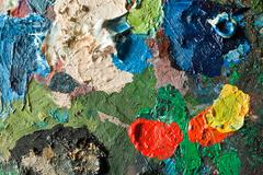 closeup of artists palette with mixed oil paint - stock photo