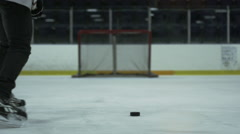 Slow Motion Hockey - Slap Shot from Behind Player Stock Footage