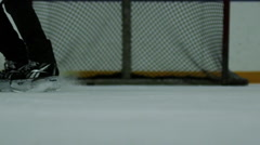 Slow Motion Hockey - Stopping close up on skates Stock Footage