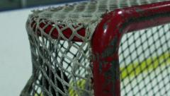 Slow Motion Hockey - Puck scores in top corner of net - stock footage