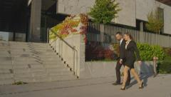 SLOW MOTION: Business people approaching office building in the morning Stock Footage