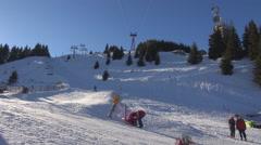Tourist people enjoy winter ski sport piste skier wintersport sunny day mountain Stock Footage