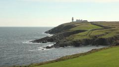 Panning shot of impressive seascape with lighthouse Stock Footage