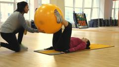 Young woman doing fitness exercise with fit ball Stock Footage