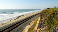 Motion Control Dolly Shot of Railroad Track by Beach -Dolly In- - stock footage