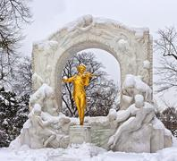 Statue of Johann Strauss in winter in Vienna Stadtpark - stock photo