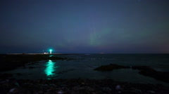 Grotta light house starry night with northern lights aurora glow, Reykjavik,  Stock Footage