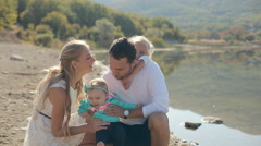 Portrait of a perfect family consisting of mom, dad and two beautiful daughters Stock Footage