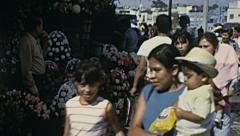 Mexico city 1973: people walking in the street in front a flower stand Stock Footage