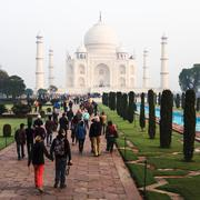 Tourists at the Taj Mahal in Agra, India - stock photo
