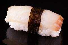 yellowtail hamachi  nigiri on black - stock photo