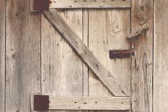 wooden barn door detail, textured view with vintage effect - stock photo