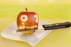 Vampire face in the apple Stock Photos