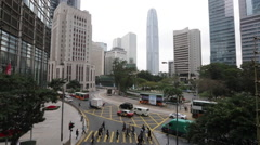 Pedestrians and vehicles near IFC in Hong Kong Central Stock Footage