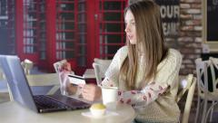 Young woman have online shopping via laptop in cafe Stock Footage