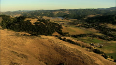 Aerial USA California Pacific farmland forest hills vegetation - stock footage