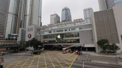 Vehicles run under an Apple store at IFC  in Hong Kong Central - stock footage