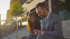 CLOSE UP: Businessman and businesswoman getting good news over smartphone Stock Footage