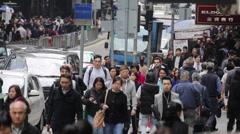 Pedestrians walk along a street in Hong Kong Central Stock Footage