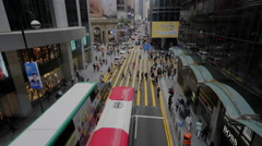 Time Lapse of pedestrians and buses in downtown Hong Kong Stock Footage
