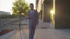 Happy businessman gets great news over smartphone Stock Footage