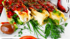 Cannelloni served on square white plate Stock Footage