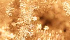 Yellow tinsel christmas decoration - close-up photo Stock Photos