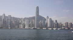 A speed boat drives past Hong Kong Central - stock footage