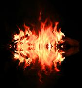 Flame of fire with water reflection - stock photo