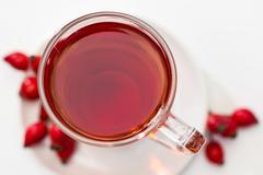 Glass of rosehip tea isolated on white background.  tisane Stock Photos