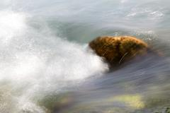 Background of turbulent water in the mountain river Stock Photos