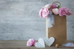 Romantic background with roses and handmade hearts Stock Photos