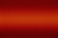 gradient red color perforated metal sheet - stock photo