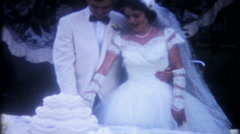 1408 - newlyweds are cutting the wedding cake - vintage film home movie - stock footage