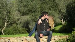 Young couple in park playing suprise Stock Footage