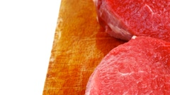 Three fresh beef fillet chops with thyme twig Stock Footage