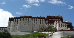 4k4k time lapse of clouds rolling Potala with willow in Lhasa,Tibet. Stock Footage