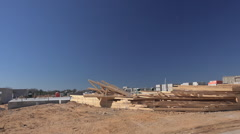 Lumber and materials on construction site.  Drive by Stock Footage