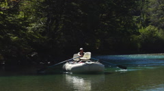 Argentina Fly Fishing - Guide in Raft - Boat arrives 01 - stock footage