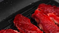 Raw bloody beef steaks Stock Footage