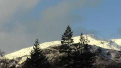 Time Lapse of Moon setting behind snow covered mountains    b00000b Stock Footage