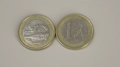 Two 1 finnish euro coins on the table Stock Footage