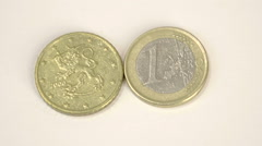 A 2000 version of a finnish euro coin and a 1 euro coin Stock Footage