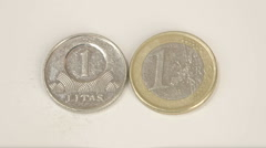 Old lithuanian 1 litas coin and a 1 lithuania euro coin Stock Footage