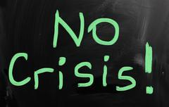 """No crisis!"" handwritten with white chalk on a blackboard - stock illustration"