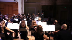 Classical music concert performed by soloists and orchestra. - stock footage